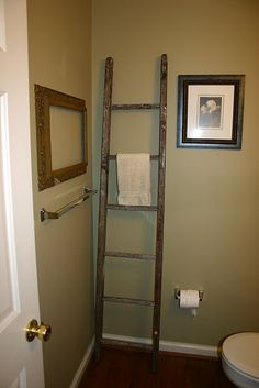 An old ladder to hang towels from. I like it!