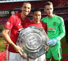 Ibrahimovic poses with fellow scorer Jesse Lingard and United goalkeeper David de Gea...
