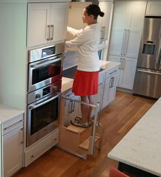 kitchen step kitchens remodel hideaway solutions hideawaysolutions on pinterest the 180 cabinet stool remains hidden until you need a leg up