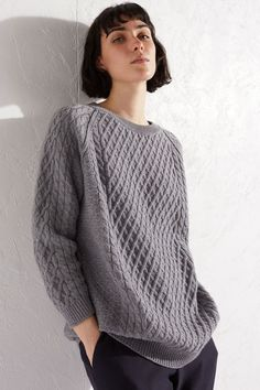 In a roomy longline shape, this grey boyfriend-style Aran Sweater is knit from 100% merino wool. Perfect for styling and layering in the cold-weather months, this ultra-warm crew-neck sweater has a chunky textured finish.