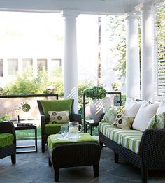 On the porch's south side, custom-built louvered shutters provide sun control and privacy. That, combined with a ceiling fan and fuss-free all-weather furnishings, create a comfy gathering space for family and friends.
