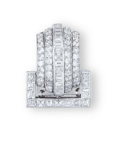 AN ART DECO DIAMOND CLIP BROOCH, BY CARTIER  The clip brooch designed as a buckle set with rectangular-shaped diamonds, to the convex shaped rectangular panel, set with a central row of baguette-cut diamonds, flanked by two rows of old European-cut diamonds, mounted in 18k white gold, 2.6 cm long, with French assay mark for gold, in red leather Cartier case  Signed and with maker's mark for Cartier, France, No. 3126