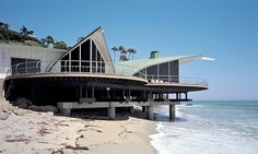The Wave House by Harry Gesner.  http://www.nytimes.com/2012/03/15/garden/the-architect-harry-gesner-still-riding-that-wave.html?_r=1&src=dayp
