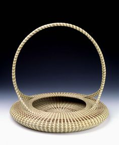 Low Basket with Handle    1999 Mary Jackson Born: Mount Pleasant, South Carolina 1945 coiled sweetgrass, pine needles, and palmetto 16 x 17 in. (40.6 x 43.2 cm) diam. Smithsonian American Art Museum