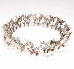 This crown called the Butterfly Tree by renowned artist Merry Renk would not be out of place in our Summer's Day exhibition. ----------- Merry Renk (1921-2012), Butterfly Tree (Californiana series), crown--silver and gold, 2 x 9 x 9 in. executed in 1982-2009, photo: Christie's.
