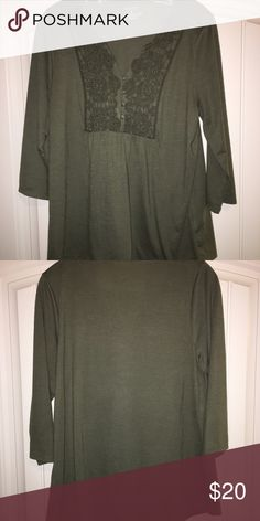 Green Shirt This shirt has been worn a few times and is great to be worn with jeans or dress pants. It is in great condition and comfortable to wear. Tops