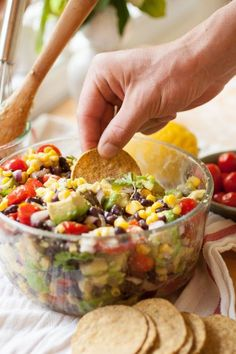 Summer Corn, Avocado & Black Bean Salad is your perfect summer snack! Serve with tortilla chips and try not to eat the entire bowl!