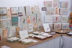 Those lucite racks really make the cards stand out. {craft booth setup}