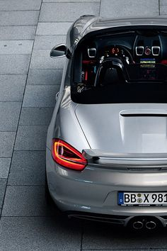 2012 Porsche Boxter the lines on the back if this car are amazing, from the lights to the spoilers, back to the lights