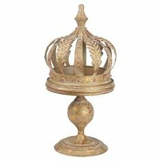"""Perfectly placed on your foyer or desk, this distressed iron tray features a crown-shaped lid and charming pedestal base.  Product: Tray with coverConstruction Material: IronColor: GoldDimensions: Small: 17.75"""" H x 8.5"""" DiameterLarge: 20"""" H x 11"""" Diameter"""