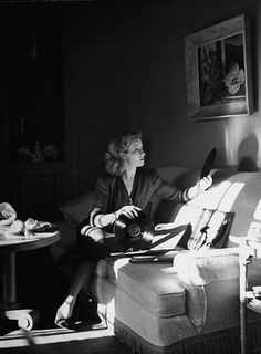 Greer Garson sits her living room at home in Los Angeles' exclusive Bel Air neighborhood, picking out records to play, 1943. Photo by Peter Stackpole