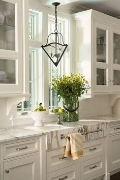 Classic White Kitchen - white subway tile, Calcutta marble countertops, white cabinetry and stainless hardware - Tobi Fairley, New House Diary:  The Kitchen Color Palette