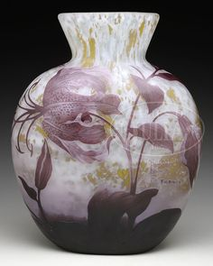 """DAUM NANCY CAMEO TIGER LILY VASE. Large Daum vase with rounded body and flared rim is decorated with purple cameo Tiger Lily blossoms, stems and leaves set against a heavily mottled yellow and white acid-textured background. Signed in cameo on the side of vase """"Daum Nancy"""" with Cross of Lorraine."""