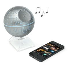 """Meet the iHome Death Star Bluetooth Speaker. When you're not using it, it's a lovely c. 4 1/2"""" diameter Death Star on an acrylic stand. When you are using it, it's a wireless speaker with one-touch connectivity to your Bluetooth device."""