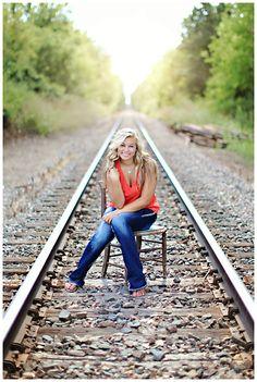 pose on railroad tracks
