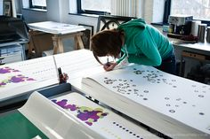 Rachael Clewlow signs her edition prints for the Hilton Hotel and London 2012 Olympics