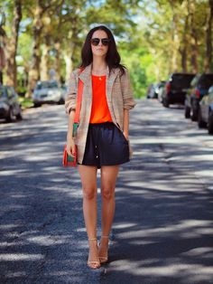 orange tank top with black shorts and cardigan
