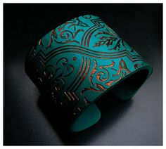 Adriana Allen rubs in copper foil to create the lovely variation of embers in this polymer clay cuff bracelet, as seen on The Polymer Arts blog, http://www.thepolymerarts.com/blog/