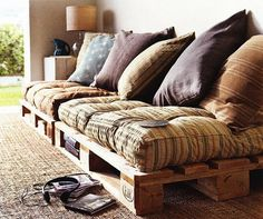 Make this pallet couch. Use linen or wool blankets for zip off covers.
