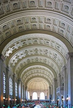 Boston Public Library's Bates Hall, the main reading room of the library, is a perfect example of the impressive decor and architecture of the library.