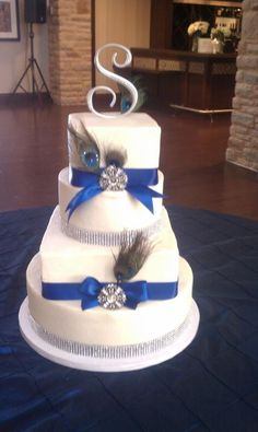 Peacock feather and diamond wedding cake maybe with a lighter blue or purple ribbon