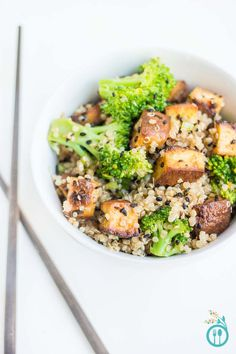 A healthy, vegetarian and gluten-free quinoa stir-fry made with crispy bake tofu, steamed broccoli and a spicy sesame sauce.