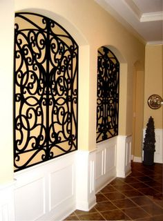 Tableaux® Faux Iron Designer Grilles are easy to install. Simply mark and pre-drill peg hole locations, insert anchors and align your Tableaux. Insert screws, cap all peg holes to conceal the screws heads, et voila - You're done! Visit Tableaux.com today for design inspiration and to find an Authorized Tableaux Reseller in your neck of the woods. | Pictured: Tableaux faux iron grille. Application: Wall decor. Design: Custom. Color: Custom. Interior Design: private residence, hallway.