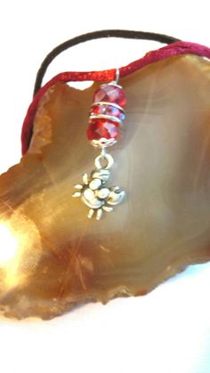 Check out this item in my Etsy shop https://www.etsy.com/listing/452705756/crab-dangle-bracelet-scarlet-swarovski