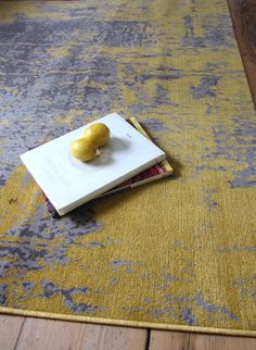 Revive RE11 Mustard Yellow Rug... A subdued mustard type of yellow alongside light grey and a slightly distressed look that combines well with its flatweave type construction (it's less than a centimetre deep). We at www.AppleRugs.co.uk think it works best in light rooms.