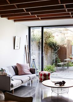 The renovated North Fitzroy cottage of Daniel Stray and Kc Reynolds. Production – Lucy Feagins / The Design Files. Via I love the table stand! Style At Home, Living Room Inspiration, Home Decor Inspiration, Home Living Room, Living Spaces, Cottage Living, Living Area, Cottage Design, House Design