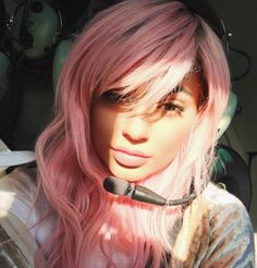 Hello pink hair!  Kylie Jenner is the queen of trying new hair colors and hairstyles and she is at it again! She posted this selfie in a helicopter featuring her new pink hair with long bangs. She enjoyed the helicopter ride with boyfriend Tyga Sunday morning. Kylie is a master in the hair and makeup department and we can't wait to see what she will surprise us with next! Instagram: @kyliejenner Twitter: @KylieJenner Photo: Kylie Jenner/Instagram