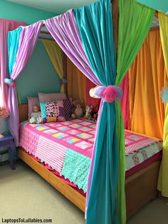 Laptops to Lullabies: DIY canopy bed with rainbow curtains