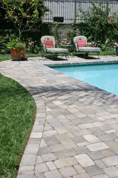 Pavers around a pool. More expensive than poured concrete but no cracking!!!