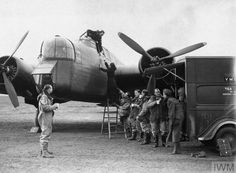 Armstrong Whitworth Whitley Mk III and crew, with YMCA tea car in attendance, 10 January 1941.