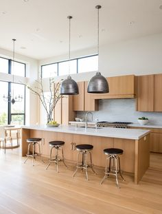 Love the simple, clean lines of the floor and cabinets.  Its modern and warm and inviting.