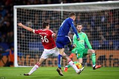 Darmian's attempted block is too late as Jamie Vardy rifles the ball beyond Manchester United goalkeeper David De Gea and into the net to put Leicester City 1-0 up.