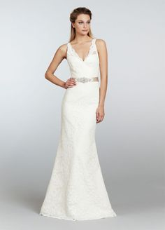 Beautiful lace wedding gown trumpet style with low v-neck front and back necklines by Tara Keely