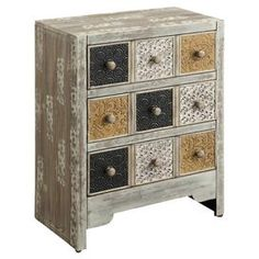 "Weathered three-drawer chest with textured panels.  Product: ChestConstruction Material: WoodColor: MultiFeatures: Three drawersDimensions: 32"" H x 25"" W x 13.5"" D"