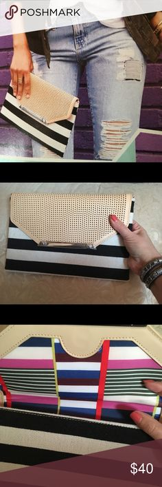 City Slim black/cream stripe clutch Black and cream stripe clutch with blush perforated faux leather detail. Patterned interior holds 6 cards. Side loops to attach chain or strap ( not included) Stella & Dot Bags Clutches & Wristlets