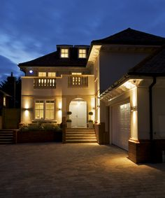 A Late Evening Exterior View Of Luxury New Home With All Internal