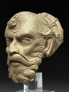 Head of an ascetic. unfired clay. 4th century Gandhara ( India)