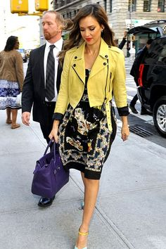 May 7 2013 - While out and about in New York, Jessica Alba wore a printed sundress with a yellow biker jacket and blue peep-toe heels.