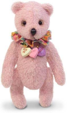 Nounours en peluche de couleur rose. *** PARFUMS DE PARIS *** CHEZ ISA *** FRANCE ***