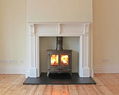 Bespoke MDF mantel with slate tiled hearth, rendered chamber and bronze Charnwood Island 2 wood stove. Fitted in Leigh on Sea Essex 2011