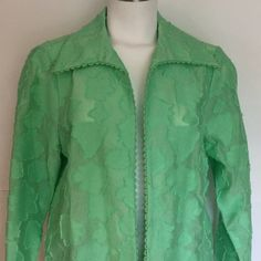 Simonton Says pretty jacket  Simonton Says , designed by George Simonton, pretty spring green light weight jacket. Leaf designs on fabric. Eyelet stitching on seams. See detail of leaves in picture. Very pretty. Think Spring! Excellent Condition. George Simonton Jackets & Coats