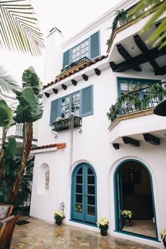 White stucco with azure trim = coastal Spanish Revival