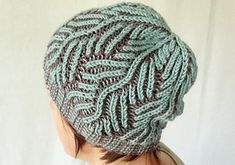 This fantastic hat is knitted by fresh two colors brioche stitch technique. By some repeating increases and decreases stitches the pine leaves are created. This is a perfect hat for you to start knitting in two colors brioche stitch, and after knitting to wear in cold days. It is more beautiful in wearing inside out. I recommend trying it!