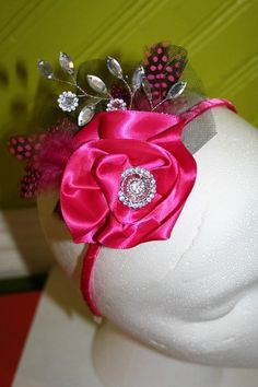 hot pink fascinator with lots of rhinestones