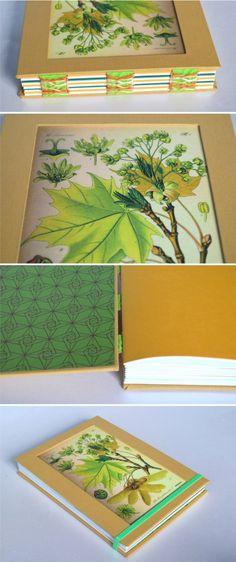 Cuaderno botánico amarillo encuadernación con costura expuesta con cinta