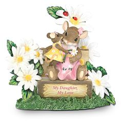 The loving bond that a mother and daughter share is one of life's most precious gifts, blossoming and growing more beautiful with each new day. Now celebrate your love with this collectible Charming Tails® mother-daughter figurine, inspired by the work of acclaimed artist Dean Griff.